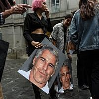 ": A protest group called ""Hot Mess"" hold up signs of Jeffrey Epstein in front of the Federal courthouse on July 8, 2019 in New York City. (Stephanie Keith/Getty Images/AFP)"