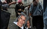 A protest group called Hot Mess holds up posters of Jeffrey Epstein in front of the Federal courthouse in New York City, on July 8, 2019. (Stephanie Keith/Getty Images/AFP)