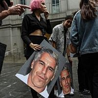 "A protest group called ""Hot Mess"" hold up signs of Jeffrey Epstein in front of the Federal courthouse on July 8, 2019 in New York City. (Stephanie Keith/Getty Images/AFP)"