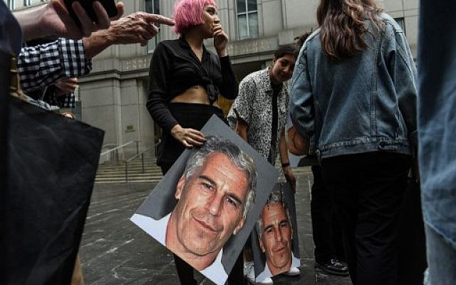 A protest group called Hot Mess holds up posters of Jeffrey Epstein in front of the Federal courthouse on July 8, 2019, in New York City. (Stephanie Keith/Getty Images/AFP)