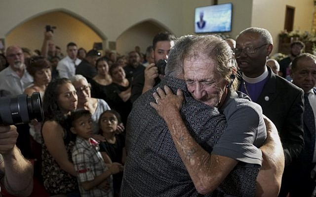 Antonio Basco greets well wishers at a public memorial for his late wife Margie Reckar, on August 16, 2019, in El Paso, Texas. Reckard was one of 22 killed during the Walmart shooting in El Paso on August 3rd. (Sandy Huffaker/ Getty Images/ AFP)