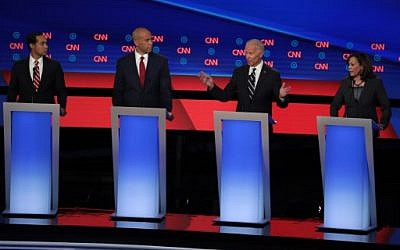 Democratic presidential candidate former Vice President Joe Biden (2nd R) speaks while Sen. Kamala Harris (D-CA) (R) and Sen. Cory Booker (D-NJ) and former housing secretary Julian Castro listen during the Democratic Presidential Debate at the Fox Theatre July 31, 2019 in Detroit, Michigan. (Scott Olson/Getty Images/AFP)
