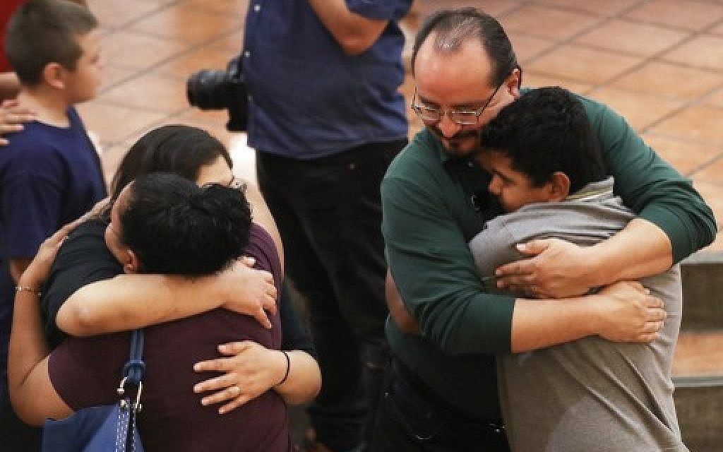 People hug at St Pius X Church at a vigil for victims after a mass shooting which left at least 20 people dead on August 3, 2019 in El Paso, Texas. (Mario Tama/Getty Images/AFP)