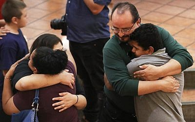 People hug at St Pius X Church at a vigil for victims after a mass shooting that left at least 20 people dead on August 3, 2019, in El Paso, Texas. (Mario Tama/Getty Images/AFP)