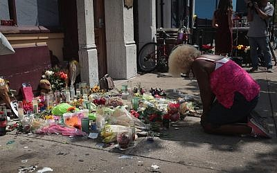 Annette Gibson-Strong visits a memorial to those killed in yesterday's mass shooting in the Oregon District, on August 5, 2019, in Dayton, Ohio. (Scott Olson/Getty Images/AFP)