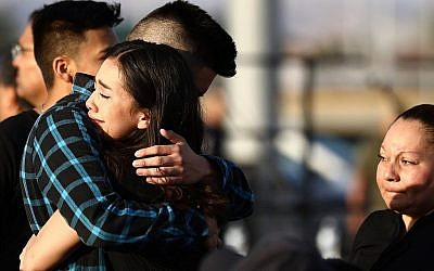 Mourners embrace at a vigil honoring Horizon High School sophomore Javier Amir Rodriguez, who lost his life in a mass shooting in nearby El Paso, on August 5, 2019 in Horizon City, Texas. (Mario Tama/Getty Images/AFP)