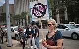 Demonstrators outside of the Dayton City Hall protest a planned visit of President Donald Trump on August 6, 2019 in Dayton, Ohio.  (Scott Olson/Getty Images/AFP)