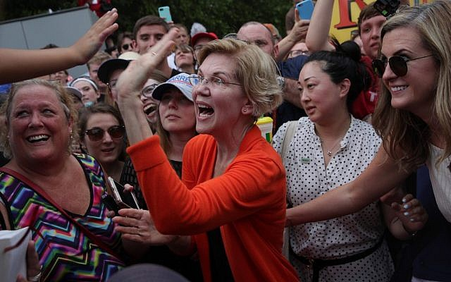 Democratic presidential candidate U.S. Sen. Elizabeth Warren (D-MA) greets a supporter after she delivered a campaign speech at the Des Moines Register Political Soapbox at the Iowa State Fair on August 10, 2019 in Des Moines, Iowa. (Alex Wong/Getty Images/AFP)