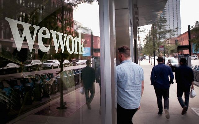 Mired in debt, WeWork files for IPO