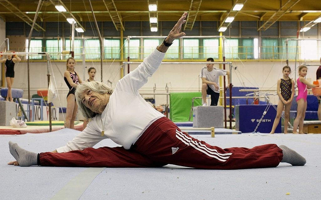 Agnes Keleti performs a split in front of Hungarian young gymnasts Budapest on January 16, 2016. (Peter Kohalmi/AFP/Getty Images/via JTA)