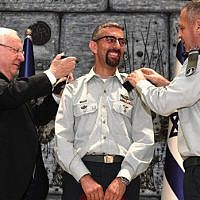 Ala Abu Rokun (center) receives his new brigadier general insignia from President Reuven Rivlin (left) and IDF chief Aviv Kohavi (right) during a ceremony at the President's Residence, on August 14, 2019 (Mark Neiman/GPO)