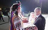 Prime Minister Benjamin Netanyahu and his wife Sara are greeted at the airport in Kiev by Ukrainians dressed in traditional outfits on August 18, 2019. (Raphael Ahren/Times of Israel)