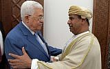 Palestinian Authority President Mahmoud Abbas and Omani Ambassador to Jordan Khamis bin Mohammed al-Faris embracing each other in Ramallah on August 6, 2019. (Credit: Wafa)
