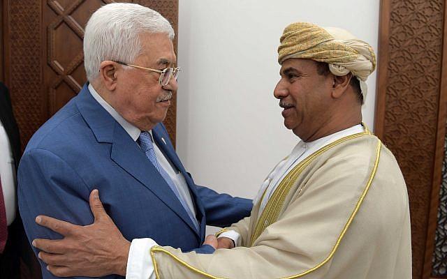 Palestinian Authority President Mahmoud Abbas and Omani Ambassador to Jordan Khamis bin Mohammed al-Faris embracing each other in Ramallah on August 6, 2019. (Credit: Wafa)