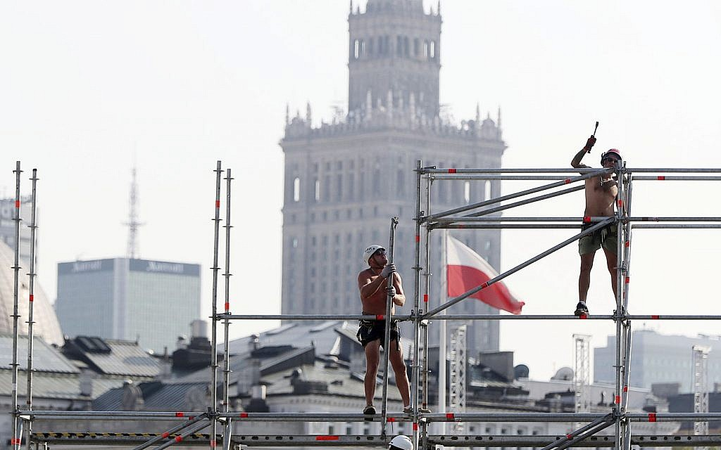 In this August 28, 2019 file photo, workers erect a stage ahead of upcoming ceremonies marking the 80th anniversary of the start of World War II, in Warsaw, Poland. (AP/Czarek Sokolowski)