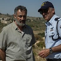 """Johnny Arbid, left, plays the grieving father of a slain Palestinian teen in """"Our Boys."""" (Ran Mendelson/HBO via JTA)"""