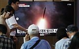 People watch a TV showing an image of North Korea's multiple rocket launch during a news program at the Seoul Railway Station, in Seoul, South Korea, August 1, 2019. (AP Photo/Ahn Young-joon)