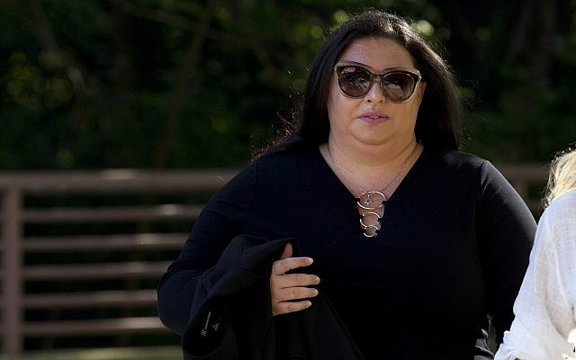 In this photo from July 16, 2019, Lee Elbaz arrives at federal court for jury selection in her trial in Greenbelt, Md. (AP Photo/Jose Luis Magana, File)