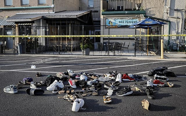 Shoes are piled outside the scene of a mass shooting including Ned Peppers bar on August 4, 2019, in Dayton, Ohio. (AP/John Minchillo)