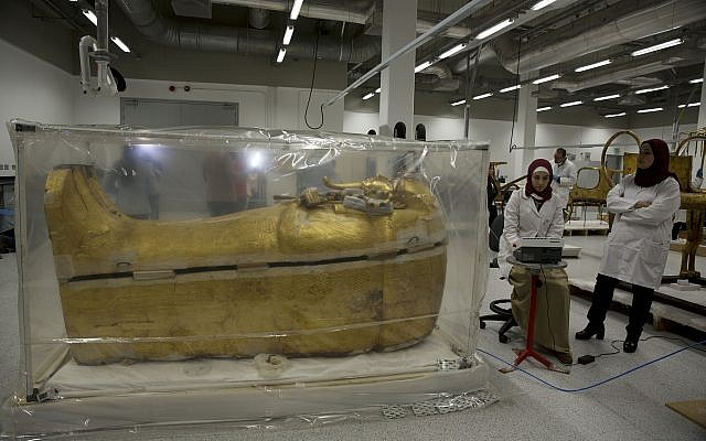 The gold-covered sarcophagus of King Tutankhamun is encased in a tent for restoration procedures at the conservation center of the the Grand Egyptian Museum in Giza, near Cairo, Egypt, August 4, 2019. (AP Photo/Maya Alleruzzo)