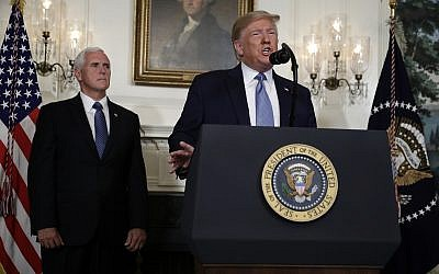 US President Donald Trump speaks about the mass shootings in El Paso, Texas, and Dayton, Ohio, in the Diplomatic Reception Room of the White House, August 5, 2019, in Washington. (AP Photo/Evan Vucci)