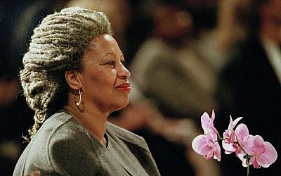 In this April 5, 1994 file photo, Toni Morrison holds an orchid at the Cathedral of St. John the Divine in New York. (AP Photo/Kathy Willens, File)