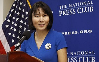 Hua Qu, the wife of Xiyue Wang, a Princeton University graduate student being held at an Iranian prison, speaks at a news conference to mark the third anniversary of her husband's imprisonment, Thursday, August 8, 2019, at the National Press Club in Washington. (AP Photo/Patrick Semansky)