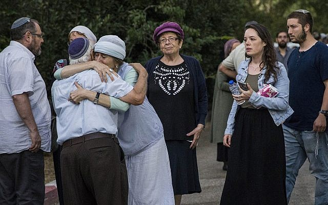 Relatives, friends and other mourners attend the funeral of Dvir Sorek, 18, at his hometown settlement of Ofra, Thursday, Aug. 8, 2019. Sorek was stabbed to death hours earlier in a terrorist attack in the West Bank south of Jerusalem. (AP Photo/Tsafrir Abayov)