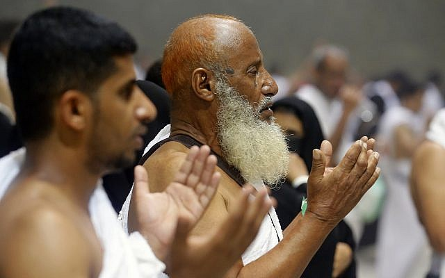 """Muslim pilgrims pray after they cast stones at a pillar symbolizing the stoning of Satan, in a ritual called """"Jamarat,"""" the last rite of the annual hajj, on the first day of Eid al-Adha, in Mina near the holy city of Mecca, Saudi Arabia, Sunday, Aug. 11, 2019. (AP Photo/Amr Nabil)"""