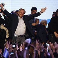 """Presidential candidate Alberto Fernandez addresses supporters at the """"Frente de Todos"""" party headquarters after primary elections in Buenos Aires, Argentina, Sunday, Aug. 11, 2019. The """"Frente de Todos"""" presidential ticket with former President Cristina Fernández emerged as the strongest vote-getter in Argentina's primary elections Sunday, indicating conservative President Mauricio Macri will face an uphill battle going into general elections in October. (AP Photo/Sebastian Pani)"""