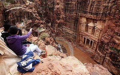 In this photo from February 13, 2017, tourists point at the Treasury, in Jordan's Petra archaeological park. (AP Photo/Sam McNeil, File)