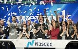 In this Jan. 16, 2018 file photo, Adam Neumann, center, co-founder and CEO of WeWork, attends the opening bell ceremony at Nasdaq in New York (AP Photo/Mark Lennihan)
