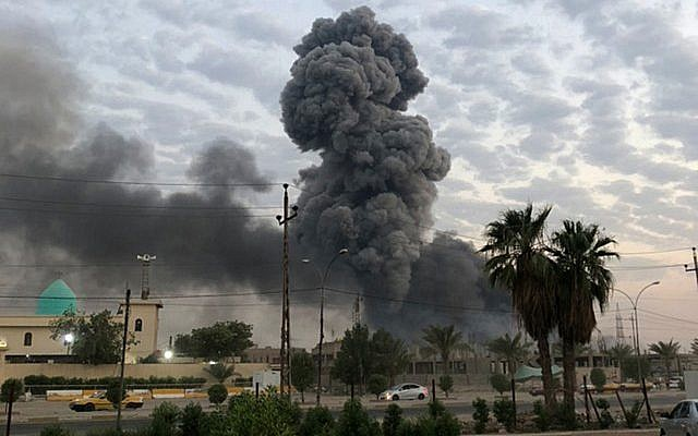 In this Aug. 12, 2019 photo, plumes of smoke rise after an explosion at a military base southwest of Baghdad, Iraq. (AP Photo/Loay Hameed)