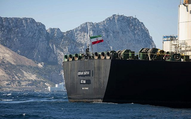 Renamed Adrian Aryra 1 super tanker hosting an Iranian flag sails in the waters in the British territory of Gibraltar, August 18, 2019. (AP Photo/Marcos Moreno)