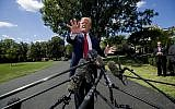 US President Donald Trump speaks with reporters before departing on Marine One on the South Lawn of the White House, August 21, 2019, in Washington. (AP Photo/Alex Brandon)