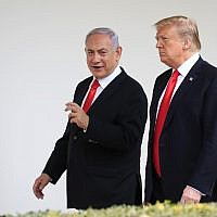 US President Donald Trump, right, and visiting Israeli Prime Minister Benjamin Netanyahu walk along the Colonnade of the White House in Washington, March 25, 2019. (Manuel Balce Ceneta/AP)