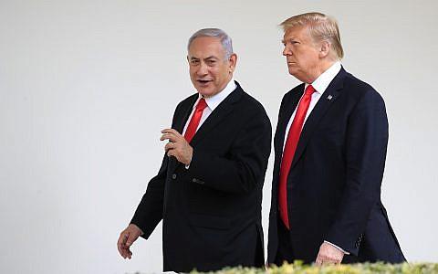 US President Donald Trump, right, and visiting Israeli Prime Minister Benjamin Netanyahu walk along the Colonnade of the White House in Washington, March 25, 2019. (Manuel Balce Ceneta/AP)
