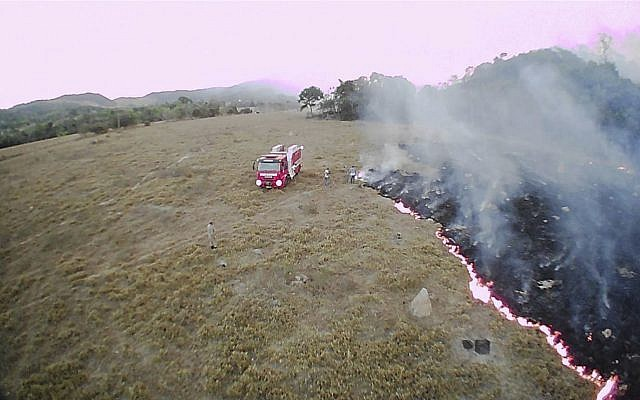 In this August 20, 2019 drone photo released by the Corpo de Bombeiros de Mato Grosso, brush fires burn in Guaranta do Norte municipality, Mato Grosso state, Brazil. (Corpo de Bombeiros de Mato Grosso via AP)