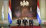 President Mario Abdo Benitez, center, talks to Israel's new ambassador to Paraguay, Yoed Magen, left, as Foreign Minister Antonio Rivas Palacios, right, listens, during official ceremony, at Lopez Palace, Asuncion, Paraguay, August 21, 2019. (Anibal Ovelar/Paraguay's Government Press Office via AP)