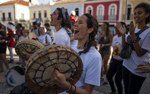 Protesters sing and play drums during a march against the Brazilian government's environmental policies, on the sidelines of a climate change meeting in Salvador, Brazil, August 21, 2019. (AP Photo/Victor R. Caivano)