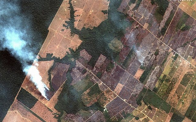 This August 15, 2019 satellite image from Maxar Technologies shows a fire and cleared land southwest of Porto Velho, Brazil. (Satellite image ©2019 Maxar Technologies via AP)