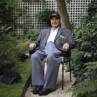 Gregory J. Melikian, a 20-year old Sergeant working in SHAEF headquarters of Supreme Commander General Dwight D. Eisenhower in 1944 and 1945, and a witness in the surrender of the high German Authorities in Reims, France, poses during an interview with the Associated Press on August 23, 2019 in Paris. (AP/Daniel Cole)