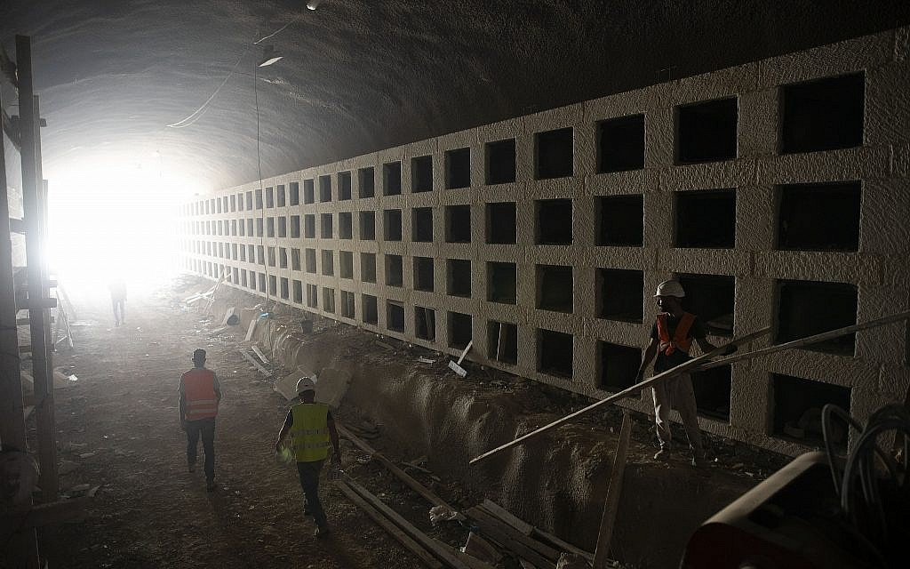 Workers walk at the construction site of a massive underground cemetery in Jerusalem,  August 18, 2019. (Oded Balilty/AP)