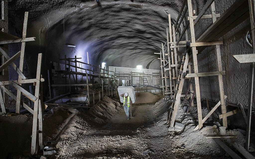 A worker walks at the construction site of a massive underground cemetery in Jerusalem, August 18, 2019. (Oded Balilty/AP)