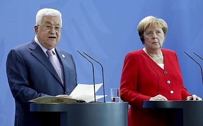 German Chancellor Angela Merkel, right, and Palestinian Authority President Mahmoud Abbas, left, address the media during a joint statement prior to a meeting at the Chancellery in Berlin, Germany, August 29, 2019. (AP Photo/Michael Sohn)