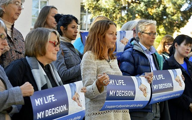Illustrative: In this October 26, 2015, file photo, right to die advocates rally outside the New Mexico Supreme Court in Santa Fe, New Mexico, after a lawyer asked justices to allow terminally-ill patients to end their lives. (AP Photo/Russell Contreras, File)