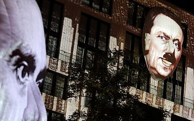 The faces of Adolf Hitler, right, and Joseph Goebbels, left, are projected onto 3D canvases as part of an art installation during a rehearsal for the 'Berlin Leuchtet' (Berlin shines) festival in Berlin, Germany, September 29, 2016. (AP Photo/Michael Sohn)