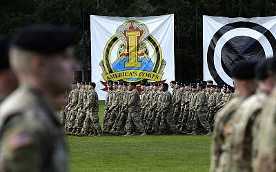 U.S. Army troops march in formation during a change of command ceremony, Monday, April 3, 2017, at Joint Base Lewis-McChord in Washington state. (AP/Ted S. Warren)