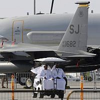 Emirati visitors pass U.S. Airforce planes during the Dubai Air Show, United Arab Emirates, November 13, 2017. (AP Photo/Kamran Jebreili)
