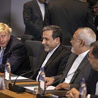 Then-British Foreign Secretary Boris Johnson, left, looks at Iranian Foreign Minister Javad Zarif, second right, during a meeting of the foreign ministers from Britain, France and Germany at the Europa building in Brussels, on May 15, 2018. (AP Photo/Olivier Matthys, Pool)